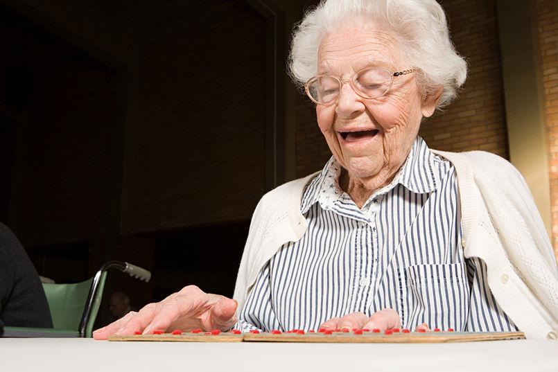 Older Woman Playing Bingo